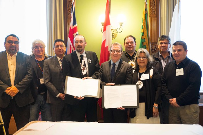 Grand Chief Jonathon Solomon and Minister David Zimmer stand with Mushkegowuk First Nations Chiefs after signing Treaty Table Memorandum of Understanding at the Ontario legislature.