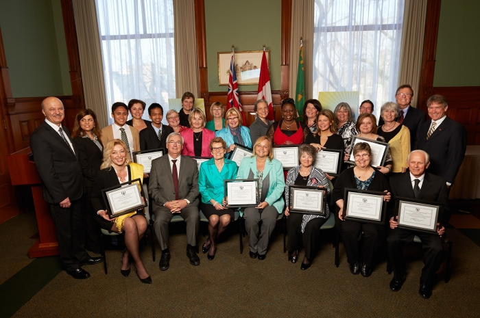 Attorney General John Gerretsen and Premier Kathleen Wynne (front row, second and third from left) with the recipients of the 2013 Attorney General's Victim Services Awards of Distinction.