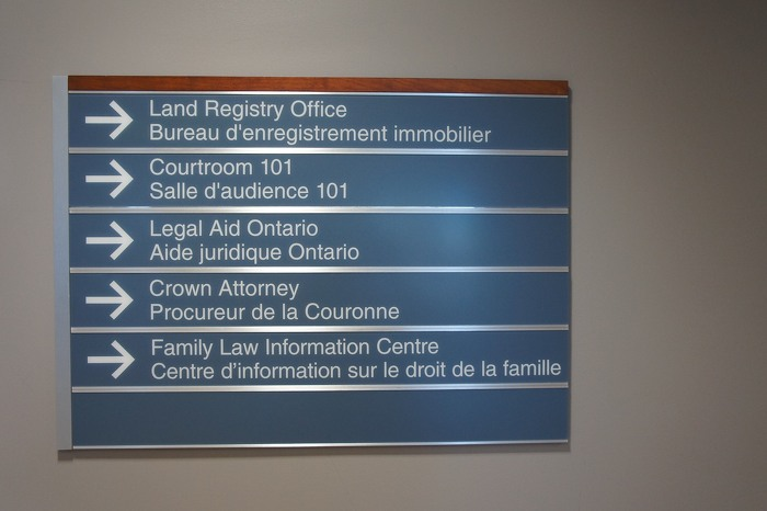 New signage at the Sarnia courthouse uses a standard design with similar fonts, colours, materials and placement of words.