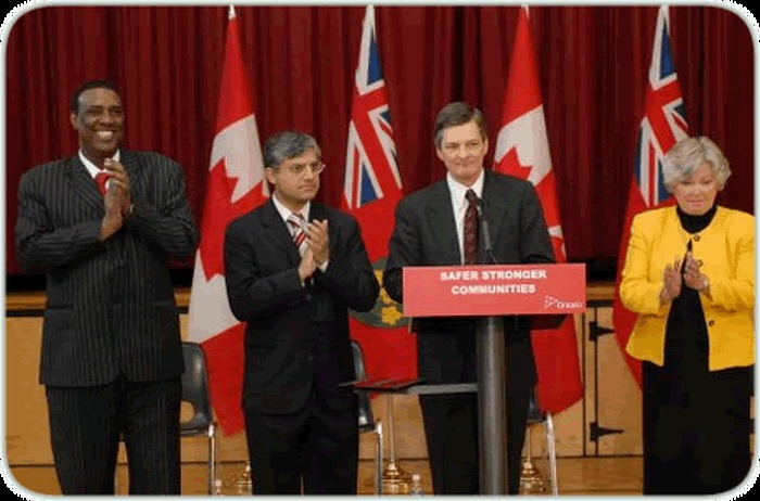 Attorney General Chris Bentley announces an anti-hate crime grant - one of 10 across the Greater Toronto Area - for the Somali-Canadian Association of Canada, at the Thistletown Multi-Service Centre, Etobicoke. The Attorney General is flanked by Donna Cansfield, Minister of Natural Resources (right), association president Osman Ali (far left) and Shafiq Qaadri, MPP for Etobicoke North.