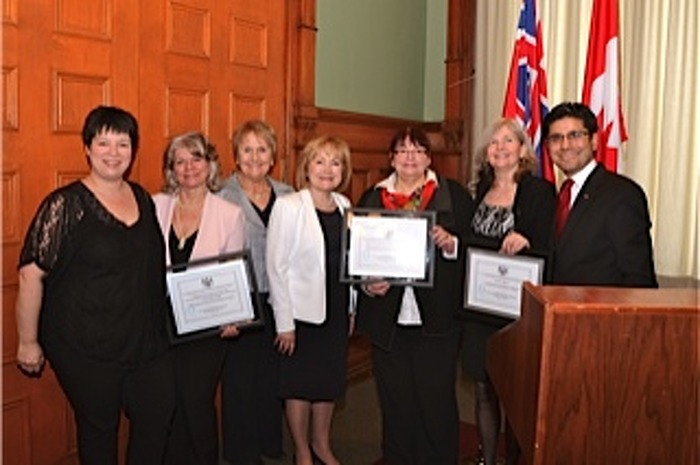 Award recipients and guests with Attorney General Madeleine Meilleur (centre) and Hon. Yasir Naqvi (right), from left, Josée Guindon, Johanne Morency, Jeanne Charlebois, Céline Pelletier and Sandy Milne.