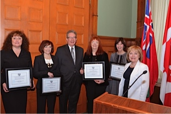 Award recipients from the Peterborough area with Attorney General Madeleine Meilleur (right) and Hon. Jeff Leal, MPP for Peterborough (centre). From left, Melissa Graham-MacDonald, Josée Bibeau, Lynn Zimmer and Mary Waters.