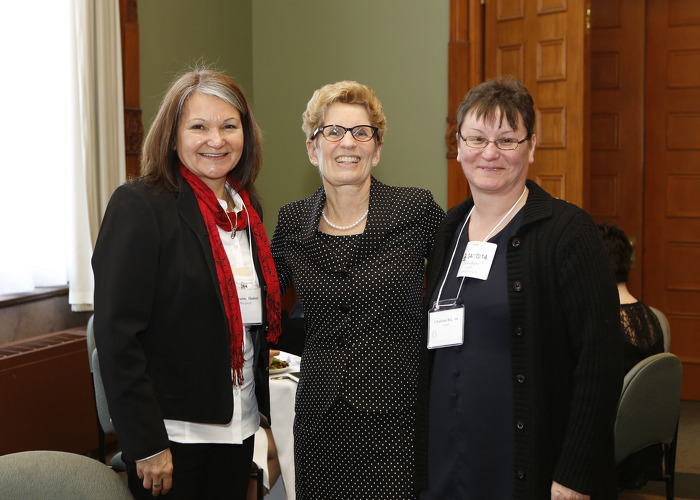 Premier Kathleen Wynne congratulates award recipient Roseanna Hudson (left) and her colleague Charlene Baglien, from Thunder Bay.