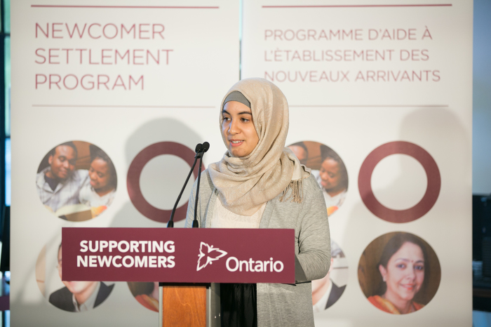 West Neighbourhood House youth client Fatima Ammari delivers remarks.