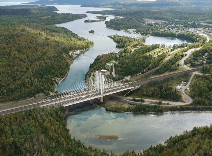 Aerial photo of the Nipigon River with an artist's rendering of the new, four-lane, cable-stayed bridge now under construction as part of the expansion of the Highway 11/17 corridor east of Thunder Bay. (McCormick Rankin)