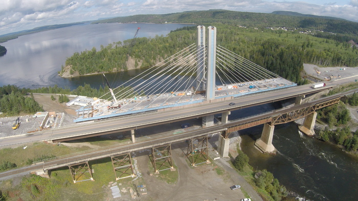Construction continues on the province's first cable-stayed bridge, located at the Nipigon River crossing on Highway 11/17. This distinctive structure will consist of three towers with cables supporting the bridge deck and a separate sidewalk for pedestrians. The $106-million project is expected to be fully open to four-lane traffic in 2017. (Photo: Hatch Mott MacDonald)