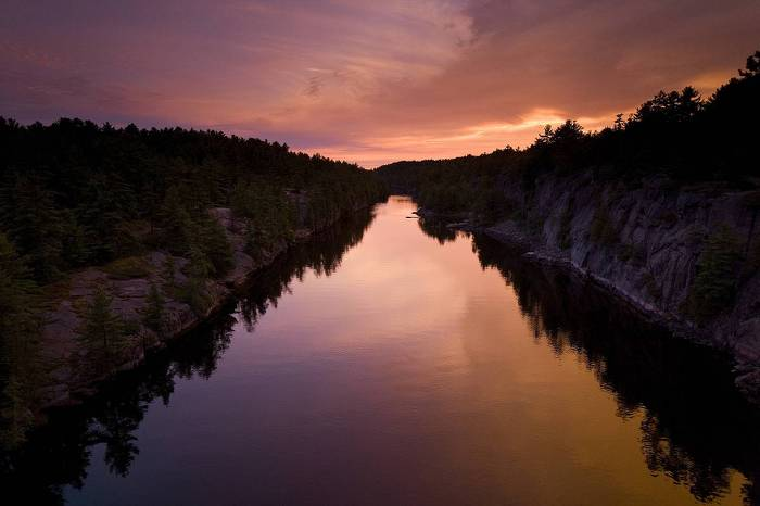 Sunset offers a breathtaking scene at French River Provincial Park, where one can enjoy a 105-kilometre span of interconnecting lakes, gorges and rapids.