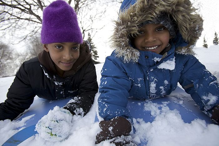 Play in the snow and find a safe  toboggan hill in your neighbourhood. Credit: Ontario Tourism Marketing Partnership Corporation