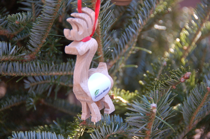 Reindeer ornaments crafted by Ontario Wood artisan, Kevin Levair, are available at Trees Ontario booth.