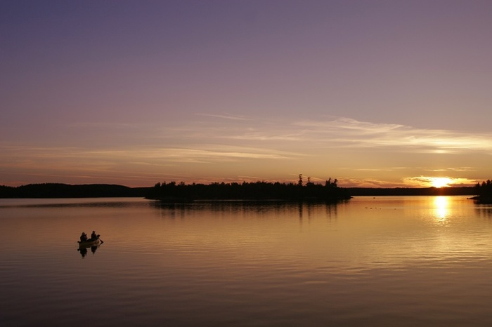 Canoeists enjoy a paddle at dusk at Missinaibi Provincial Park.