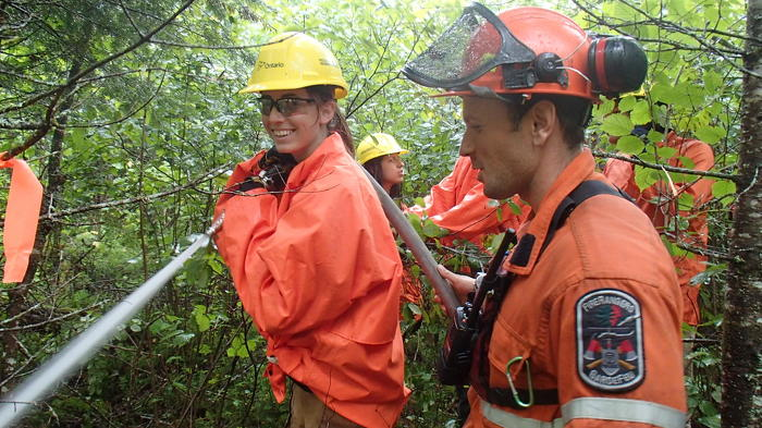 Stewardship Youth Ranger participating in mock forest fire exercise near Fort Frances.