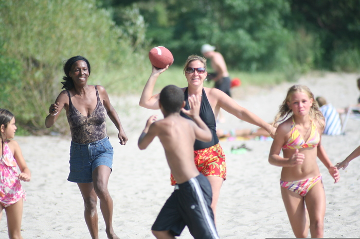 A game of football on the beach is a great way to spend time with friends – while improving your physical and mental health.