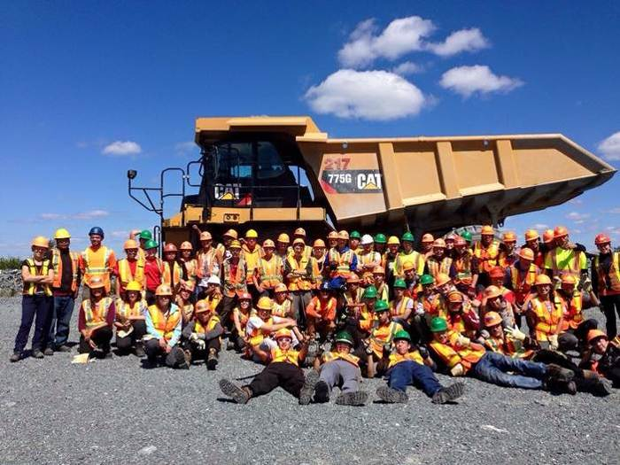 MLFNYEP and FNNRYEP participants pose in front of a hauling truck at Lac Des Illes Mine