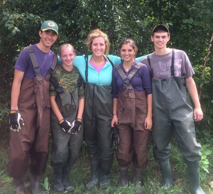 Stewardship Youth Rangers from Sudbury don their hipwaders to rehabilitate a local creek.