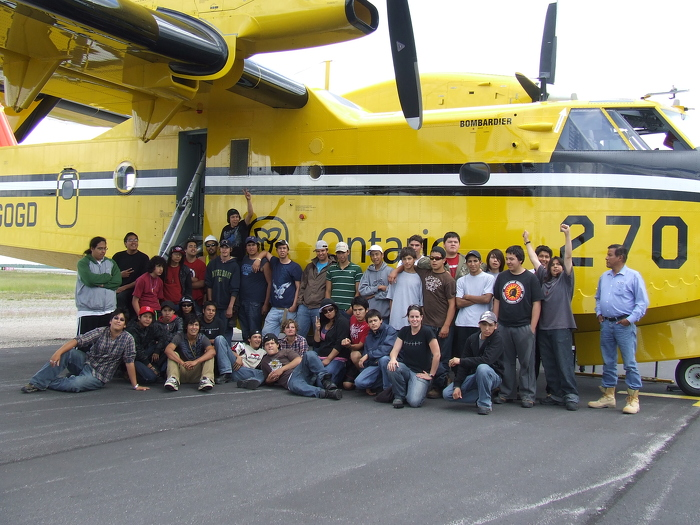 FNNRYEP youth beside an MNRF Forest Fire Water bomber plane.