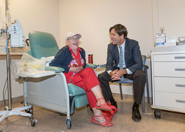 Minister Hoskins meets with patient at Lakeridge Health Hospital.
