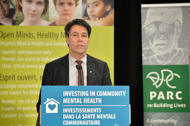 Minister Hoskins making an announcement on expanding mental health services across the province.