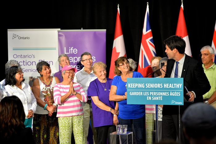 Minister Hoskins speaking before a crowd