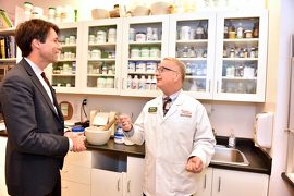 Minister Hoskins talking to Mr. James Snowdon, owner of Snowdon's Guardian Pharmacy at the event.