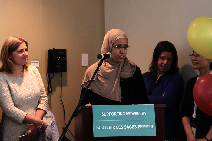 Khadija Boulaftali from the Community Midwives of Ottawa speaks at the Ottawa Birth and Wellness Centre on Saturday about the multilingual services offered by the new group.