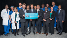 Front row (L-R): MPP Han Dong; Minister Hoskins; Dr. Charlie Chan, UHN Interim President & CEO; Dr. Shaf Keshavjee, UHN Surgeon in Chief; Ms. Janet Newton, TWH Vice President and Site Lead; and Mr. Cornell Wright, UHN Board Trustee and partner at Torys LLP.