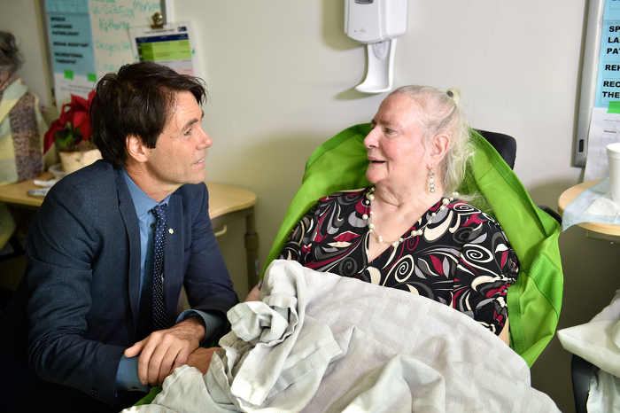 Minister Hoskins visits with a patient at the Reactivation Care Centre.