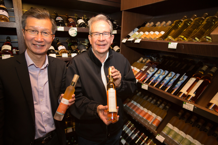 Ice wine is just one of the Ontario products Ministers Leal and Chan see on the shelves during a tour of a BHG store in Beijing, April 18, 2015.