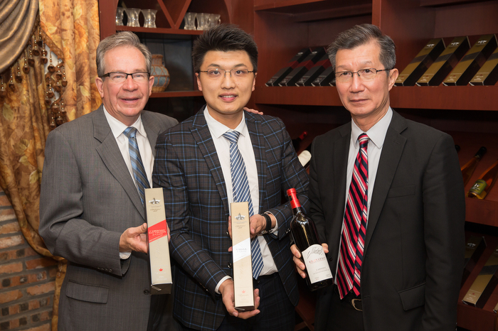 Ministers Leal and Chan with representatives from L'Huillier Wine Company, Chinese partner of Vineland Estates Winery, in Ta'ian China.