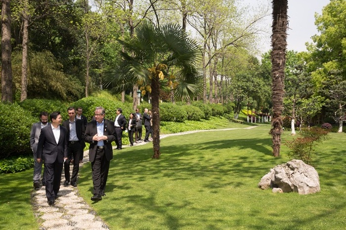 Jiangsu government officials give Ministers Leal and Chan a tour the gardens of a government building in Nanjing, Jiangsu, China, April 21, 2015.