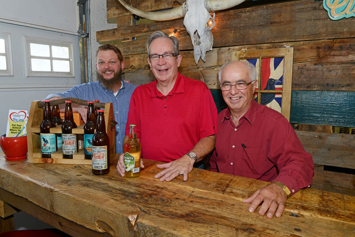 Minister of Agriculture, Food and Rural Affairs, Jeff Leal (centre), Lou Rinaldi, MPP for Northumberland-Quinte West, and Chris McRae, owner of Empire Cider Co (left).