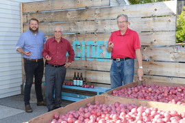 Minister of Agriculture, Food and Rural Affairs, Jeff Leal (right), in Codrington, Ontario with Lou Rinaldi, MPP for Northumberland-Quinte West, and Chris McRae, owner of Empire Cider Co (left).