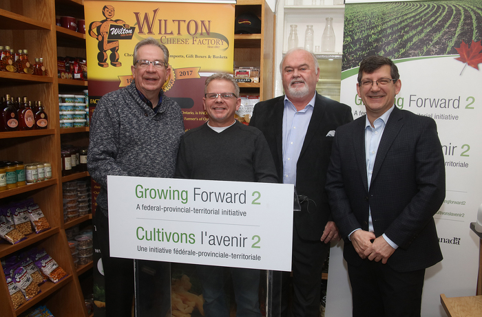 Celebrating Support for Ontario Food Processors: Ontario Agriculture Food and Rural Affairs Minister Jeff Leal, Wilton Cheese Factory manager Dave Larkin, Loyalist Township Mayor Bill Lowry and Hastings – Lennox and Addington Member of Parliament Mike Bossio (left to right) pose for a photo in connection with a Growing Forward 2 announcement, at the business, on Wednesday, Jan. 24, 2018. Wilton Cheese received almost $18,000 under the initiative to support an upgrade of a refrigeration unit. It was one of more than 300 Ontario food processor projects supported by GF2  announced at the site that day.