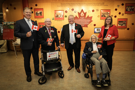 Premier Doug Ford with staff and residents of the Sunnybrook Veterans Centre. Left to right: Dr. Andy Smith, President and CEO; Richard Ratcliffe, President Sunnybrook Veterans' Council and Korean War Veteran; Premier Doug Ford; Joan Preston, RAF, Women's Auxiliary Air Force; CEO Sylvia Brachvogel, Operations Director, Veterans Centre