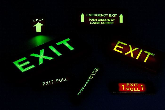 A sample of SRB Technologies (Canada) Inc.'s self-luminous safety signs made for the aerospace, military, commercial and industrial building sectors.